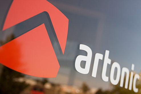 A photo of Artonic's logo on a window; shows an example of great photography taken with a phone.