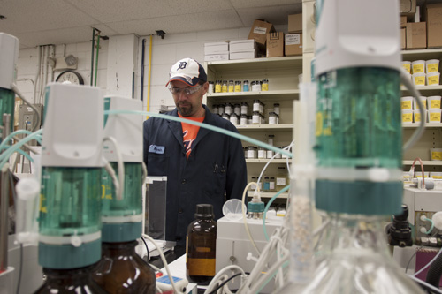 Michigan chemical manufacturing photo example of employee with chemicals in lab