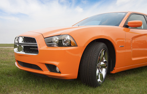 Orange Mustang on the green grass in Michigan