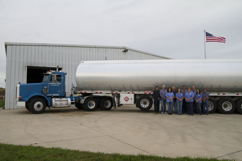 Lenawee Fuels employees line up in front of tanker for website photo shoot