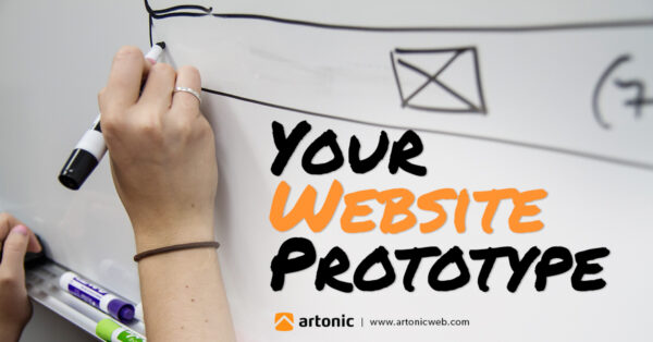 Drawing a website wireframe on the whiteboard during a meeting at Artonic