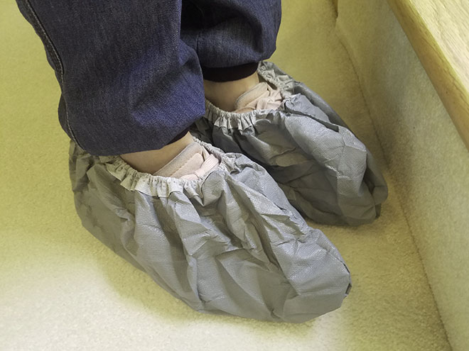 tennis shoes covered with cloth booties