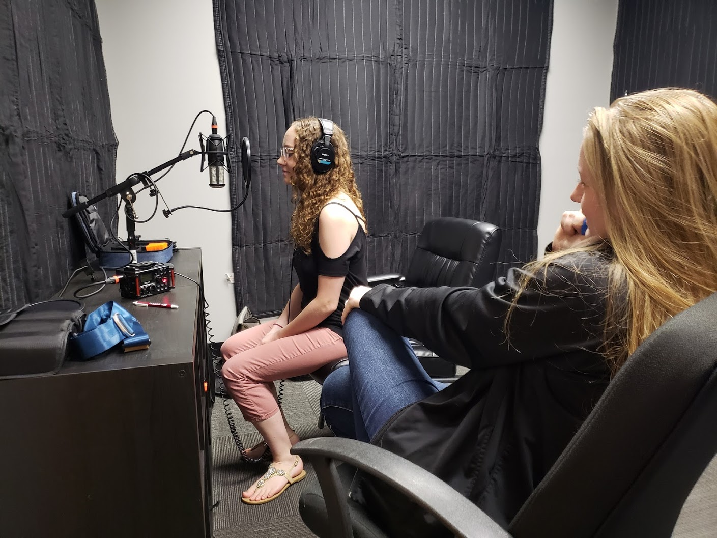 Maddie recording audio for a client