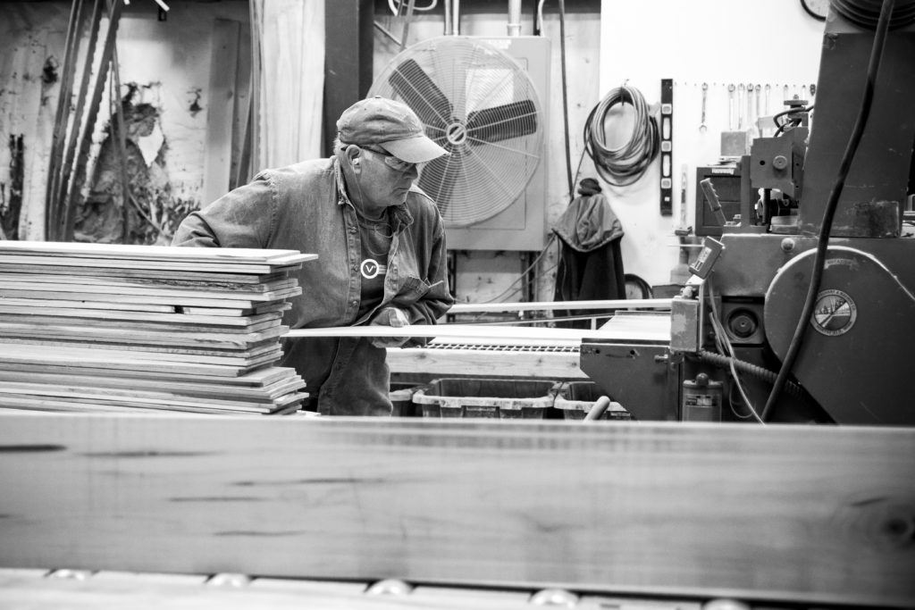 Website photography of man in a manufacturing factory. American hardwood flooring manufacturers.