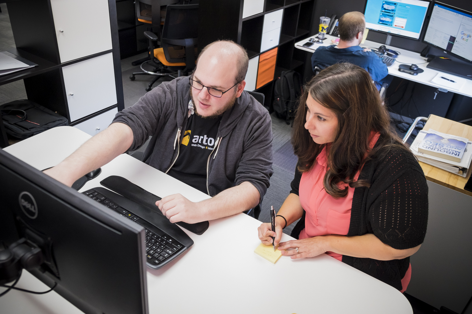 Andy and Angela working together at computer